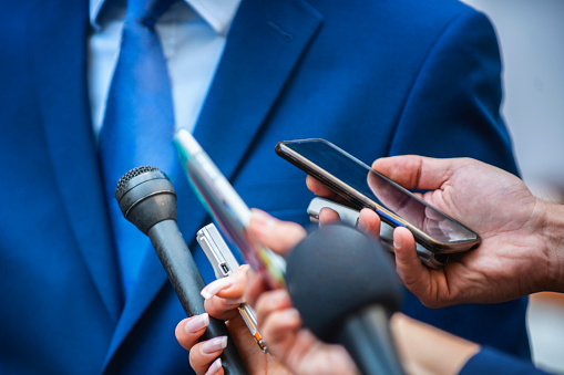 Media Interview. Journalists Interviewing Politician or Businessman 1169127480