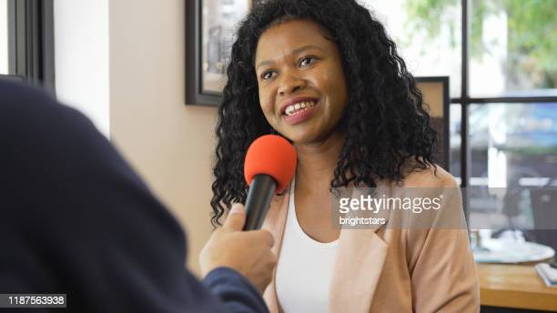 media interview with african ethnicity businesswoman - media interview stock pictures, royalty-free photos & images