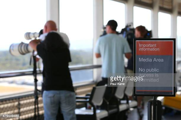 Media keep a watch on the Aeronexus Corporation's Boeing 767 used by the Rolling Stones at Perth International Airport on March 19 2014 in Perth...