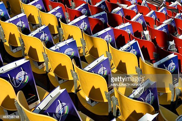 Media kits lie on chairs in the media gallery at Yelahanka Airforce Station in Bangalore on February 18 on the inaugural day of Aero India 2015 Prime...