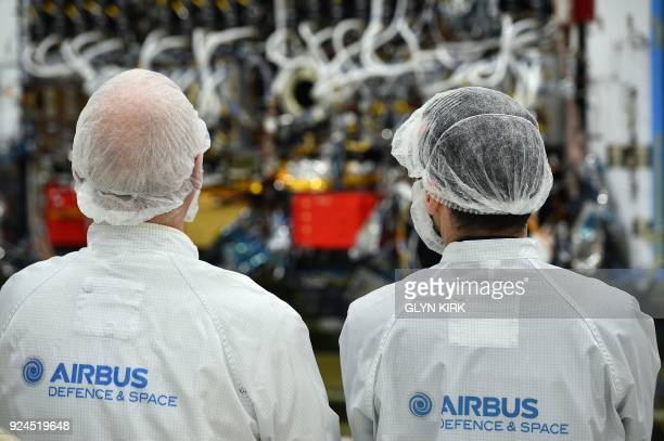 Media look at part of the Eutelsat Quantum satellite billed as the first commercial satellite to be fully configurable in orbit at Airbus Space and...
