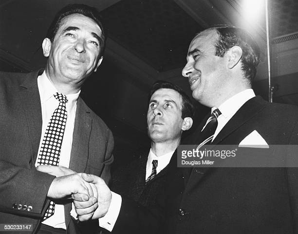 Media magnates Robert Maxwell of Pergamon Press and Rupert Murdoch of News Ltd shaking hands after a takeover meeting regarding News of the World...