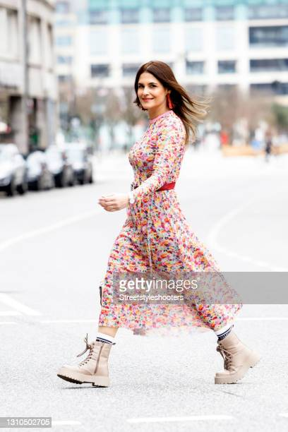 Media Manager and wife of German actor Oliver Franck Anita Franck, wearing a red patterned summer dress with a elt by Hermes, beide boots by Bianco,...