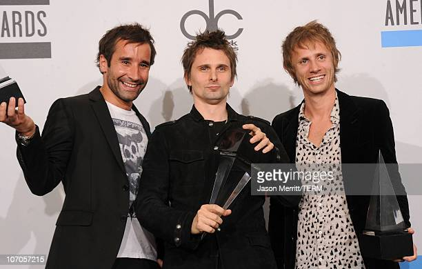 Media manager Tom Kirk with Matthew Bellamy and Dominic Howard of the band Muse pose with the awards for Favorite Alternative Rock Music Artist in...