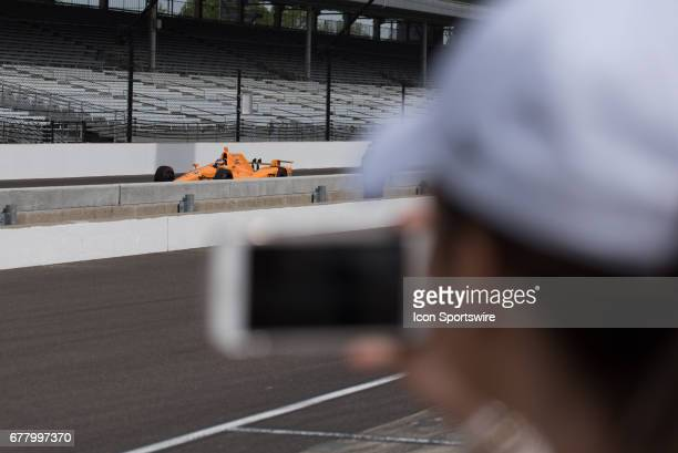 A media member films Fernando Alonso during his first test on May 03 at the Indianapolis Motor Speedway in Speedway Indiana