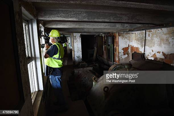 A media member takes part in a tour inside the Arlington Memorial Bridge on Monday June 01 2015 in Washington DC Completed in 1932 the bridge has...