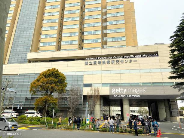 Media members gather at the National Center for Global Health and Medicine where Ken Shimura was hospitalized for COVID19 infection on March 30 2020...
