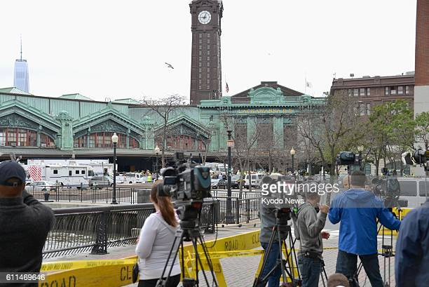 Media members gather near the NJ Transit train station in Hoboken, New Jersey, on Sept. 29 after a commuter train crashed into a platform, killing at...