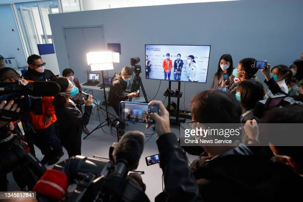Media members make remote interview after Women's 3000m match on day one of the Speed Skating China Open, a test event of the 2022 Beijing Winter...