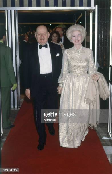 Media Mogul Lew Grade arrives at the Royal Film Performance 'Table for Five' at the Odeon in Leicester Square his wife Lady Grade, 21st March 1983.