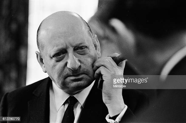 Media Mogul Lord Lew Grade speaking to a guest at a dinner party. 24th January 1967.