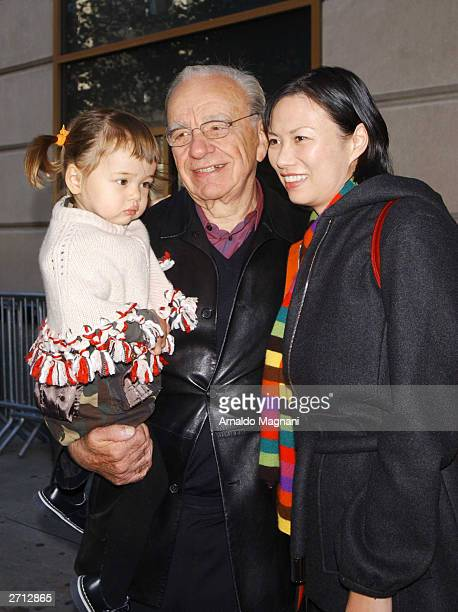 Media mogul Rupert Murdoch and his wife Wendi Deng and daughter Grace leave a movie theater after seeing Dr Seuss's Cat in the Hat November 9 2003 in...