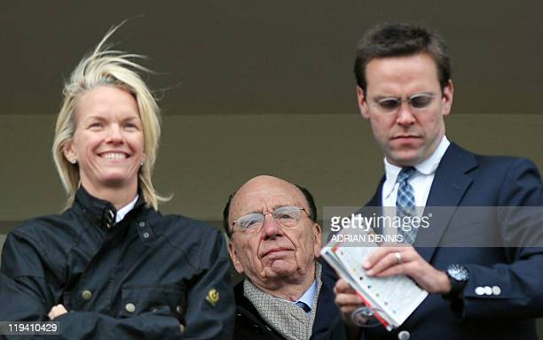 Media mogul Rupert Murdoch stands behind his children James Murdoch and Elisabeth Murdoch overlooking the racing during the third day of horse racing...