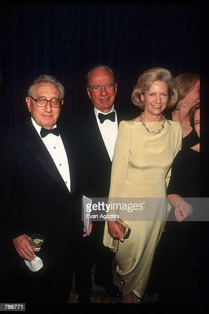 Media mogul Rupert Murdoch stands with his wife Anna and the former US Secretary of State Henry Kissinger at the Humanitarian of the Year Awards May...