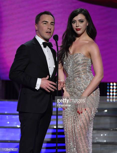 Media Network CEO Tony Rios and adult film actress Whitney Wright present an award during the 2019 Adult Video News Awards at The Joint inside the...