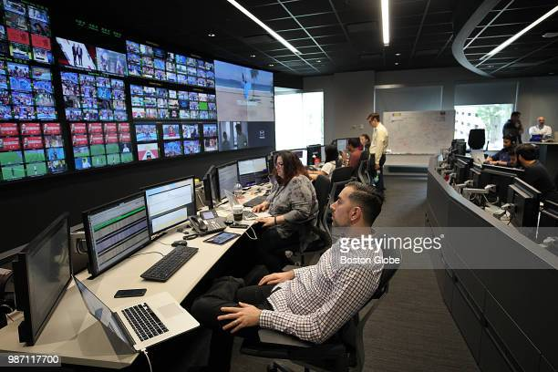 Media operations engineer Mike Shea keeps his eye on World Cup soccer in the Broadcast Operations Control Center at Akamai in Cambridge MA on June 28...
