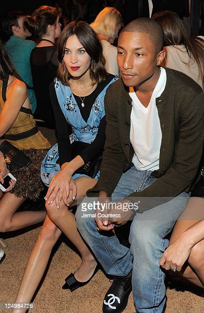 Media personality Alexa Chung and musician Pharrell Williams attend the Proenza Schouler Spring 2012 fashion show during MercedesBenz Fashion Week at...
