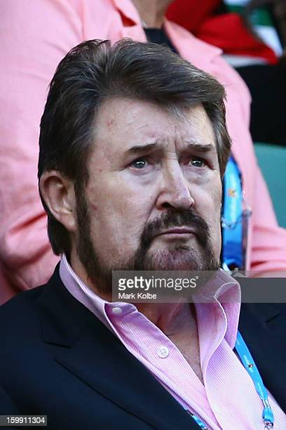 Media personality Derryn Hinch attends the Men's Quarterfinal match between Roger Federer of Switzerland and JoWilfred Tsonga of France during day...