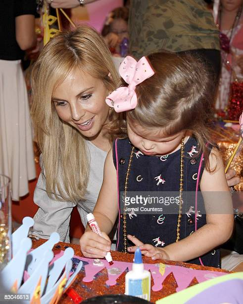 Media personality Elisabeth Hasselbeck and daughter Grace Hasselbeck create in the arts and crafts room during the 50th Anniversary Release of the...