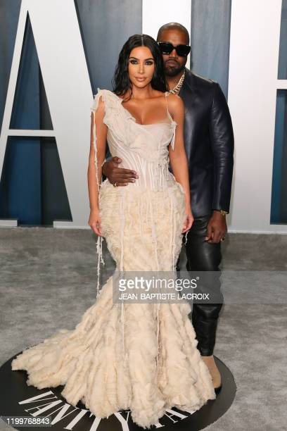 US media personality Kim Kardashian and husband US rapper Kanye West attend the 2020 Vanity Fair Oscar Party following the 92nd Oscars at The Wallis...