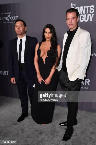 US media personality Kim Kardashian West fashion photographers Mert Alas and Marcus Piggott arrive to attend the amfAR Gala New York at Cipriani Wall...