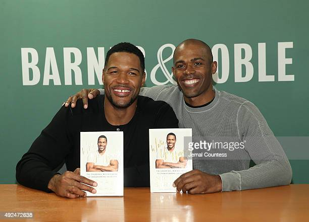 Media personality Michael Strahan and Dr Ian Smith pose for a photo during the book signing for Michael Strahan's book 'Wake Up Happy The Dream Big...