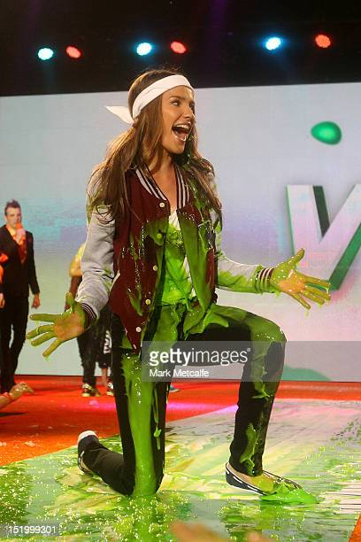 Media personality Rachael Finch slides down slime during the matinee Nickelodeon Slimefest 2012 show at Hordern Pavilion on September 15 2012 in...