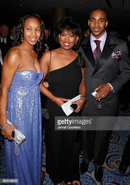 Media personality Sade Baderinwa with NFL Star David Tyree and wife Leilah Tyree during the cocktail reception at the 51st Annual New York Emmy...