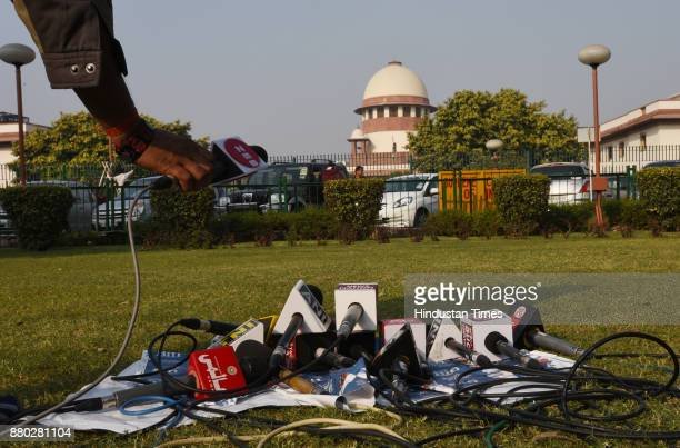 Media Personnel mikes placed on the ground as they were waiting for 24yearold Hadiya of Love Jehad fame at the Supreme Court after hearing on...