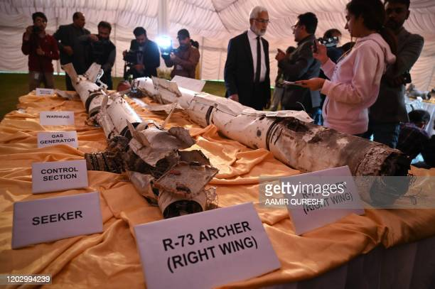 Media personnel take images of missiles of an Indian Mig21 fighter aircraft which was being flown by Indian pilot Wing Commander Abhinandan Varthaman...