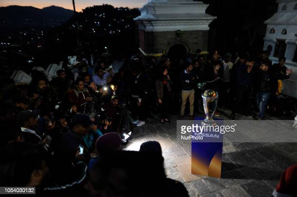 Media Personnel's gathered to take pictures and videos of 2019 ICC Cricket World Cup trophy infront Swayambhunath Stupa or Monkey Temple during a...