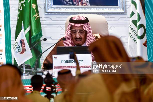 Media persons gathered at the International Media Centre in Saudi Arabia's capital Riyadh on November 21, 2020 watch on a projected screen as Saudi...