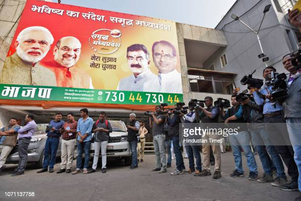 Media persons wait for Chief Minister of Madhya Pradesh Shivraj Singh Chouhan to arrive at party headquarters a day before the state election results...