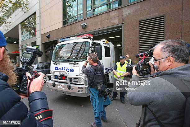 Media photograph as the police van transporting the five men who allegedly planned to travel by boat to Indonesia so they could join Islamic State in...