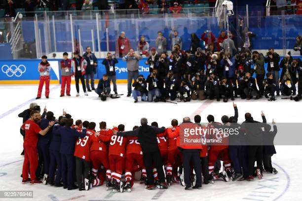Media photograph the Gold medal winners Olympic Athletes from Russia during the medal ceremony after defeating Germany 43 in overtime during the...