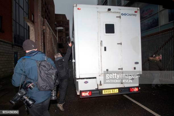A media photographer tries to take a photograph as a prison van believed to be transporting former football coach Barry Bennell arrives at Liverpool...