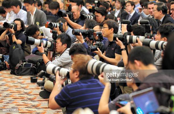 Media photographers are seen during a press conference by former Japan National Team Head Coach Vahid Halilhodzic at the Japan National Press Club on...