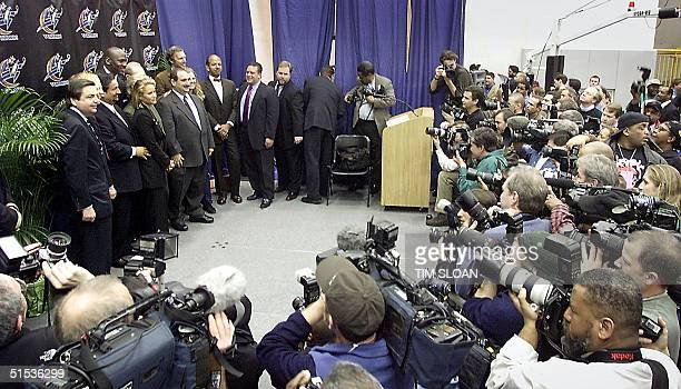 Media photographers swarm around Michael Jordan after being been named President of Basketball Operations for the NBA team The Washington Wizards at...