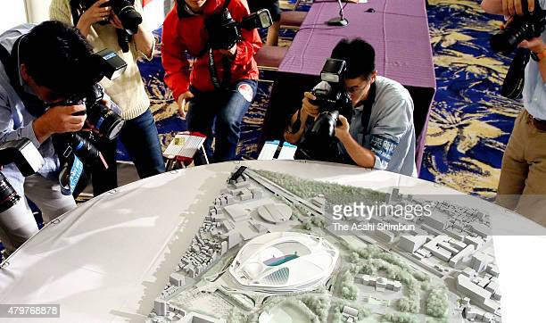 Media photographers take pictures of the new national stadium model after the New National Stadium Construction Experts Meeting on July 7 2015 in...