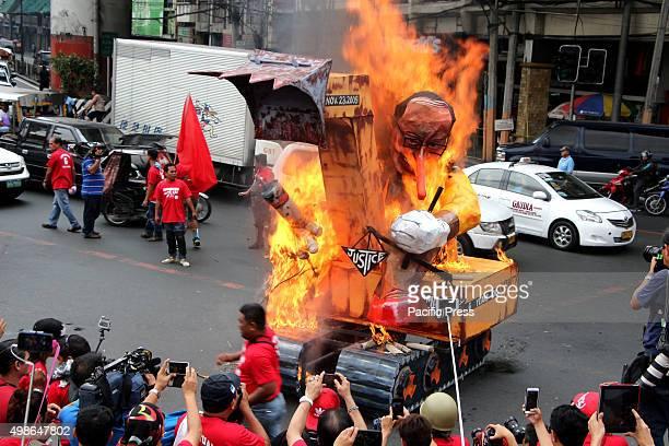 Media practitioners burned the effigy of President Benigno Aquino III as Pinocio in backhoe to commemorate the 6th Anniversary of Ampatuan Massacre...