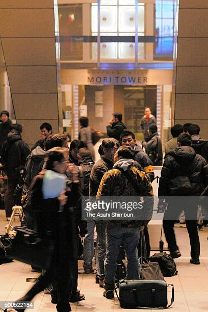 Media reporters gather at Roppongi Hills where members of the Special Investigation Department of the Tokyo District Public Prosecutors Office raid...