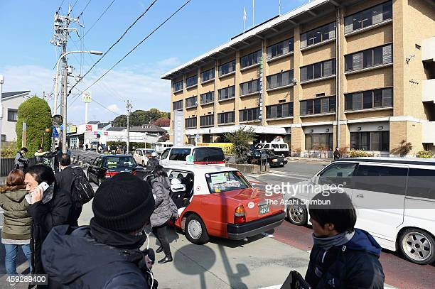 Media reporters gather in front of the Mukomachi Police Station on November 19 2014 in Muko Kyoto Japan Police arrested a fourtime widow on suspicion...