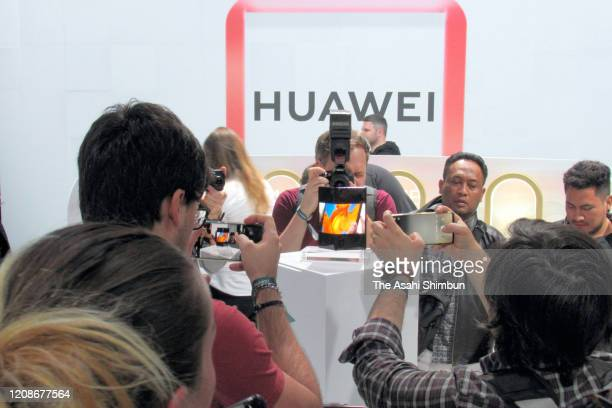 Media reporters take photographs of Huawei's new foldable mobile phone Mate Xs during its new product unveiling press conference on February 24 2020...