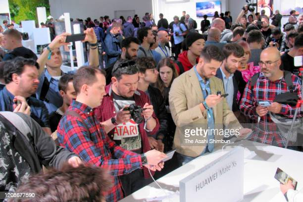 Media reporters try Huawei's new foldable mobile phone Mate Xs during its new product press conference on February 24 2020 in Barcelona Spain