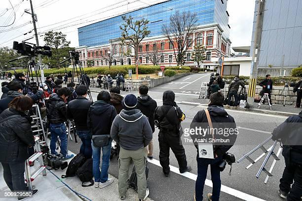 Media reporters wait for Ryutaro Nonomura leaving at the Kobe District Court on January 26 2016 in Kobe Hyogo Japan Ryutaro Nonomura a former...