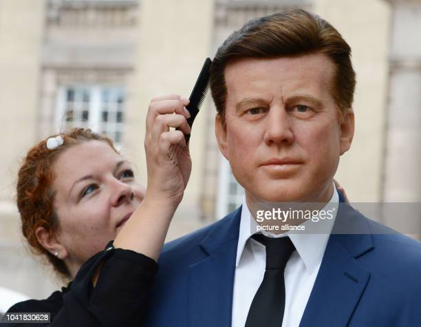 Media representative Nina Zerbe works on the Madame Tussaud's wax figure of former US President John F Kennedy in front of Rathaus Schoeneberg...