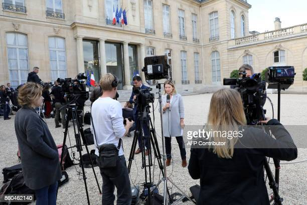 Media representatives deliver pieces to camera as they report on union leaders meetings with French President Emmanuel Macron at The Elysee Palace in...