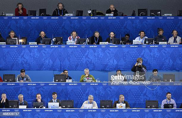Media representatives sit in the press tribune during the Women's Ice Hockey Group A match USA vs Switzerland at the Shayba Arena during the Sochi...