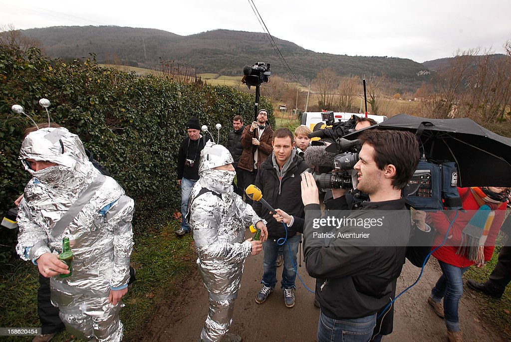 Media speak to people wrapped in silver foil in Bugarach village on December 21, 2012 in Bugarach, France. The prophecy of an ancient Mayan calendar claimed that today would see the end of the world, and that Burgarach is the only place on Earth which will be saved from the apocalypse.