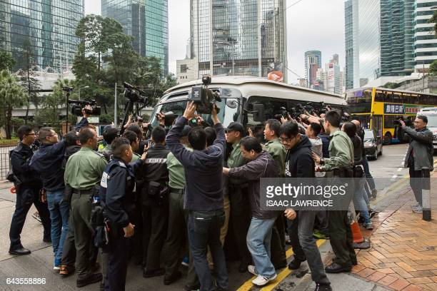 Media surround a prison van transporting former Hong Kong chief executive Donald Tsang as it arrives at the High Court for the sentencing of Tsang on...